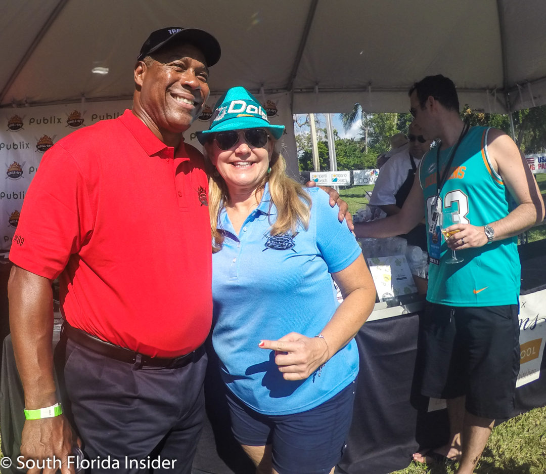 Nat Moore checks out the competition and stops to pose with a fan